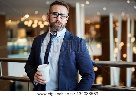 Portrait of pensive businessman with coffee