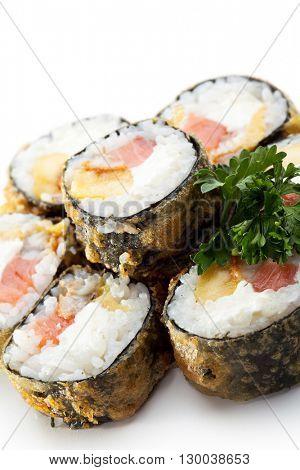 Tempura Maki Sushi - Roll made of Smoked Salmon, Smoked Eel, Pineapple and Cream Cheese inside