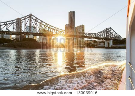 BRISBANE, AUSTRALIA - MAY 7 2016: Cruising the Brisbane river on the free ferry as the sunsets on Brisbane City.