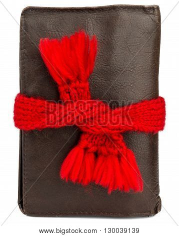 Preservation of money. Wallet wearing red scarf. Isolated on white background