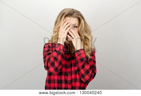 Picture Of Scared Woman Covering Her Eyes