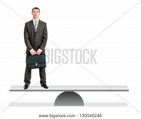 Businessman in suit standing on balance vs empty place isolated on white background