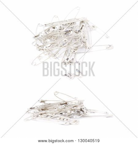 Pile of metal safety pins isolated on white background, set of different foreshortenings