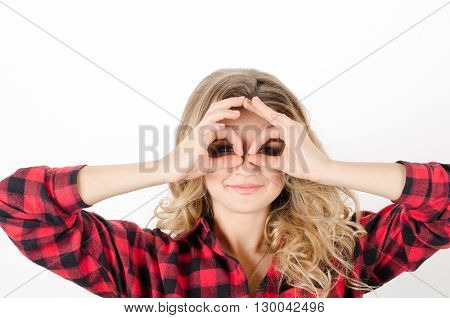 Girl Making Binoculars Hands On Eyes White Background