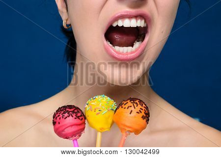 Emotive girl with red yellow and orange cakepops