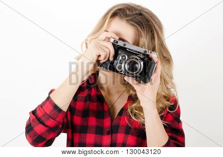 Young Woman Holding Old Retro Camera