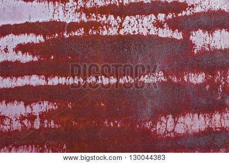 Red metallic rusted surface as a textured vintage background