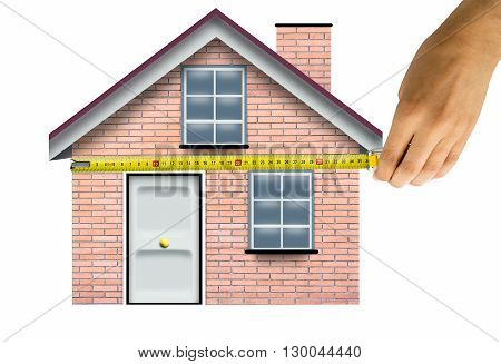 hand with a tape meter measure and a simple house