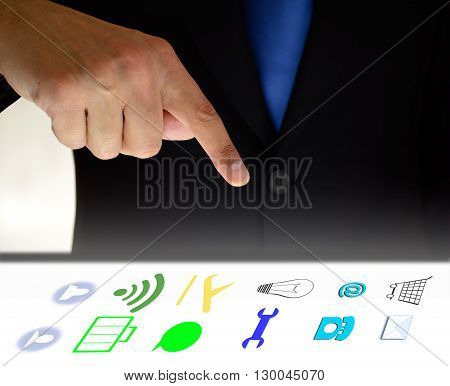 business man with social media related icons glowing over screen