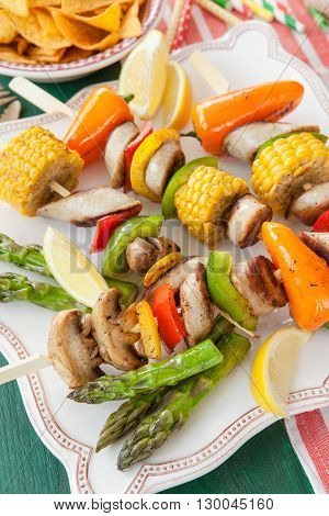 Colorful barbecue skewers with fresh vegetables and bratwurst