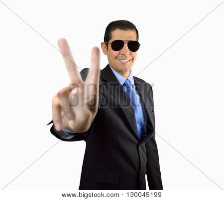 smiling bodyguard making the victory sign with his hand on white background