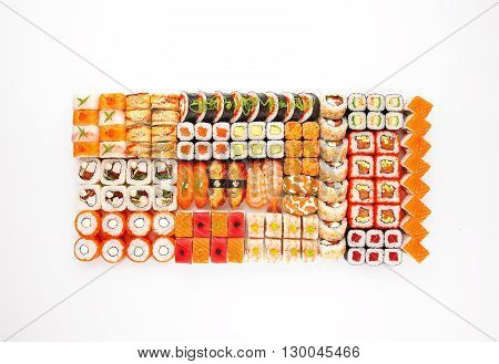 Japanese food restaurant delivery - sushi maki california gunkan roll platter big set isolated at white background, above view