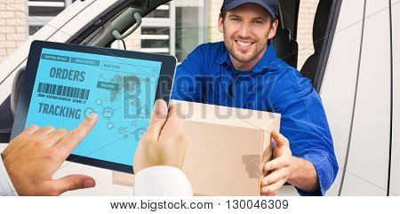 Man using tablet pc against delivery driver offering parcel from his van