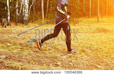 Nordic walking man. athlete jogging. sport outdoors