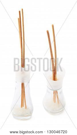 Wooden aroma sticks in a glass jar isolated over the white background, set of two different foreshortenings