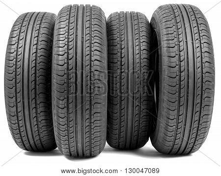 Stack of four wheel new black tyres for summer car driving isolated on white background