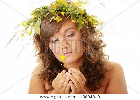 Closeup portrait of a beautiful sad young woman holding flower