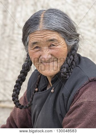 LEH INDIA - JUNE 24 2015: Unidentified beggar woman on the street in Leh Ladakh. Poverty is a major issue in India