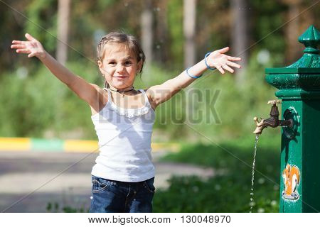 Summer girl near spring splash water park