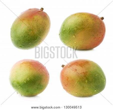 Single ripe mango fruit covered with water drops isolated over the white background, set of four different foreshortenings