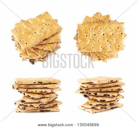 Twisted stack of raisins cracker cookies isolated over the white background, set of four different foreshortenings