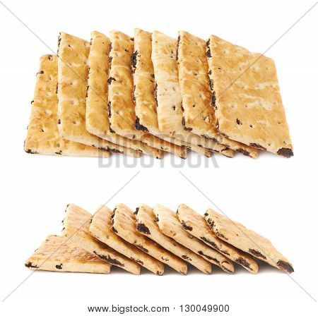 Multiple raisin cracker cookies stacked one over another, composition isolated over the white background, set of two different foreshortenings