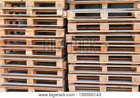 Many pallets stacked on top of each other. Construction Materials