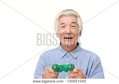 senior Japanese man losing playing video game