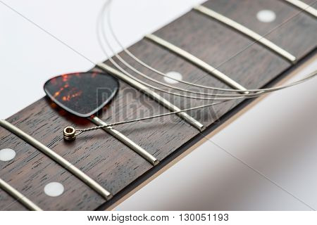 Electric guitar frets with string and mediator