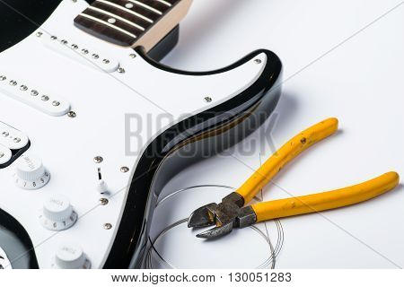 Electric Guitar With Yellow Nippers And Strings