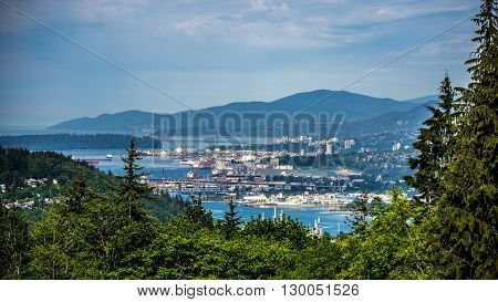 View of Burrard Inlet and the Port of Vancouver as seen from Burnaby Mountain in British Columbia, Canada