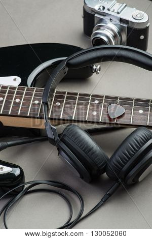 Electric Guitar With Headphones And Camera On A Brown Wooden Floor