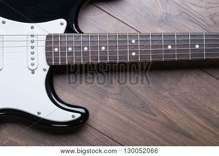 Electric Guitar On A Brown Wooden Floor