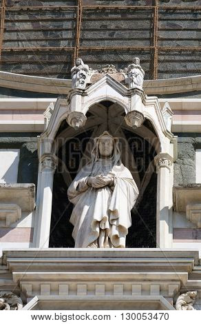FLORENCE, ITALY - JUNE 05: Statue on the portal of Basilica of Santa Croce (Basilica of the Holy Cross) - famous Franciscan church in Florence, Italy, on June 05, 2015