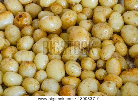 freshly cooked new potatoes covered in melted butter