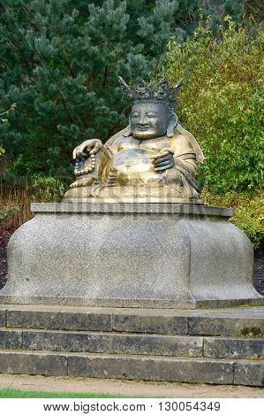 Statue of Buddha in country park uk
