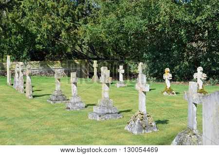Straight line of gravestones in graveyard uk