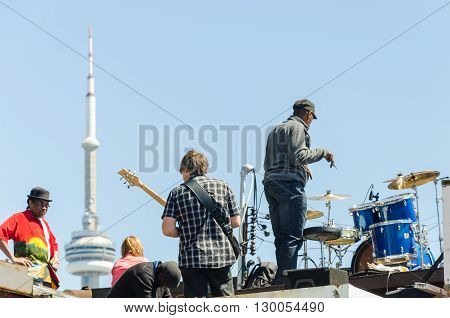 Street Artists Play On Instruments At Farmer's Market