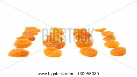 Dried orange apricots over isolated white background