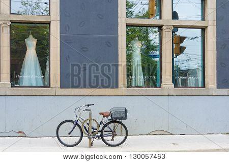 Bicycle Parked On The Storefront Wedding Dress Store, Toronto