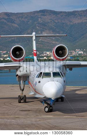 Gelendzhik Russia - September 8 2010: Beriev Be-200 amphibian cargo and firefighter plane is taxiing along the apron