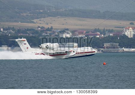Gelendzhik Russia - September 8 2010: Beriev Be-200 amphibian cargo and firefighter plane is taking off from the water surface