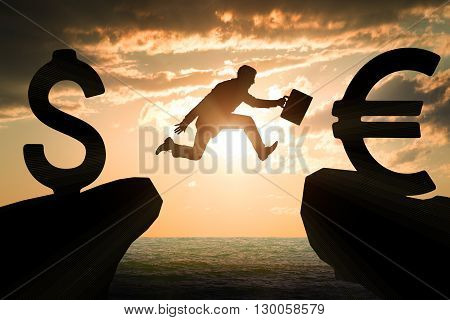 Businessman with suitcase hopping over abyss from dollar to euro