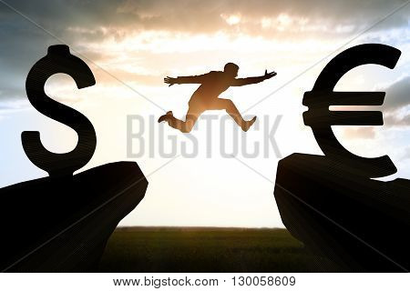 Businessman hopping over abyss from dollar to euro