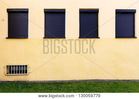 Modern yellow street wall with some windows