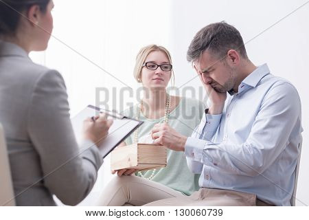 Depressed Man Crying During Therapy Session