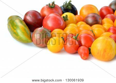 Heirloom colorful tomatoes varieties on white background