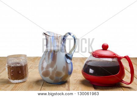 fragrant tea with milk on a wooden table