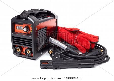 .Inverter welding machine, welding equipment isolated on white background leather gloves, welding electrodes, high-voltage wires with clips, set of accessories for arc welding.