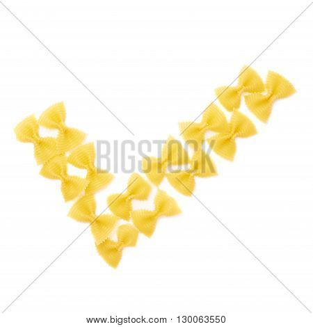 Yes tick sign symbol mark made of dry farfalle yellow pasta over isolated white background